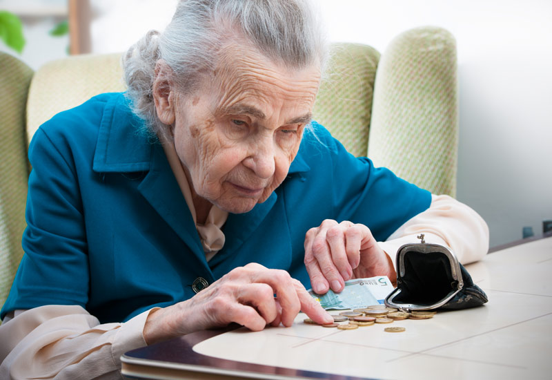 elderly woman counting change